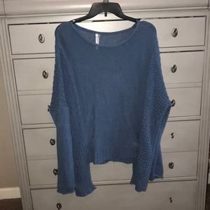 A blue size medium cropped sweater
